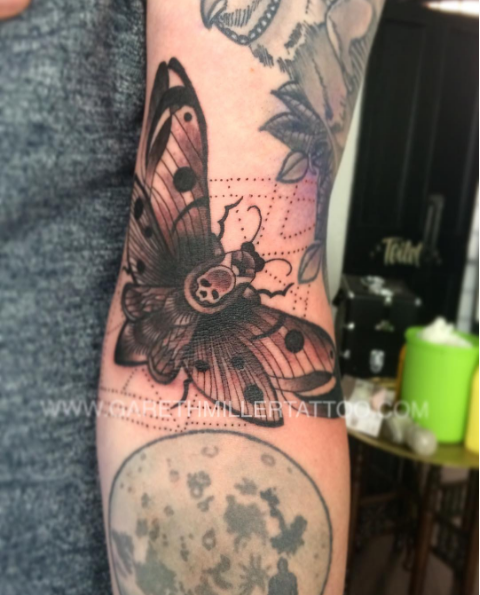 Black and grey death moth with dotwork and geometric design