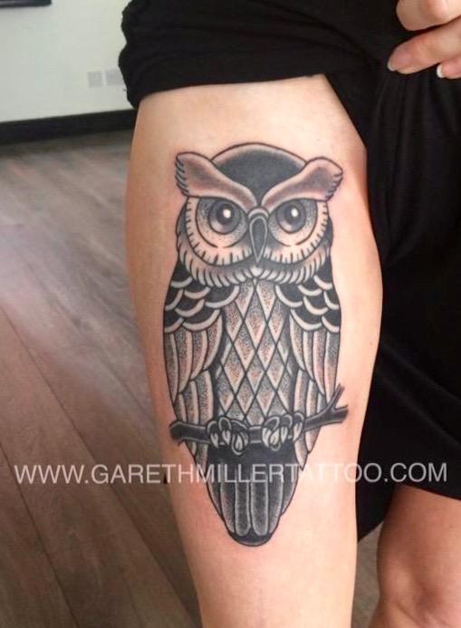 black and grey dotwork owl tattoo on girls thigh