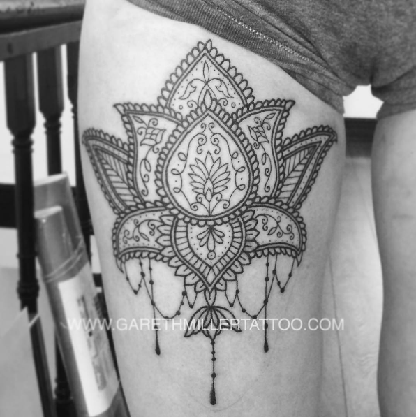 Black and grey dotwork lotus on the thigh